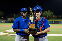 Delvin Zinn (21) and Marcus Mastrobuoni (5) hold the Chuck Jared Championship Cup after defeating the AZL Giants on September 7, 2017 at Scottsdale Stadium in Scottsdale, Arizona. AZL Cubs defeated the AZL Giants 13-3 to win the Arizona League Championship Series two games to one. (Zachary Lucy/Four Seam Images)