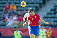 CARSON, CA - FEBRUARY 1: Ulises Segura #12 of Costa Rica heads a ball during a game between Costa Rica and USMNT at Dignity Health Sports Park on February 1, 2020 in Carson, California.