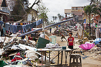 Philippines. Province Eastern Samar. Hernani. Children play in the streets. 95 % of the town was destroyed by typhoon Haiyan's winds and storm surge. Typhoon Haiyan, known as Typhoon Yolanda in the Philippines, was an exceptionally powerful tropical cyclone that devastated the Philippines. Haiyan is also the strongest storm recorded at landfall in terms of wind speed. Typhoon Haiyan's casualties and destructions occured during a powerful storm surge, an offshore rise of water associated with a low pressure weather system. Storm surges are caused primarily by high winds pushing on the ocean's surface. The wind causes the water to pile up higher than the ordinary sea level. 26.11.13 © 2013 Didier Ruef