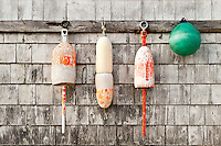 Buoys hang from a dockside shed, Bass Harbor, Maine, ME, USA