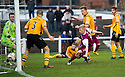Arbroath's Bobby Linn's (partially hidden at rear of pic) shot / cross goes in for their first goal.