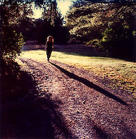 Woman walking down road<br />