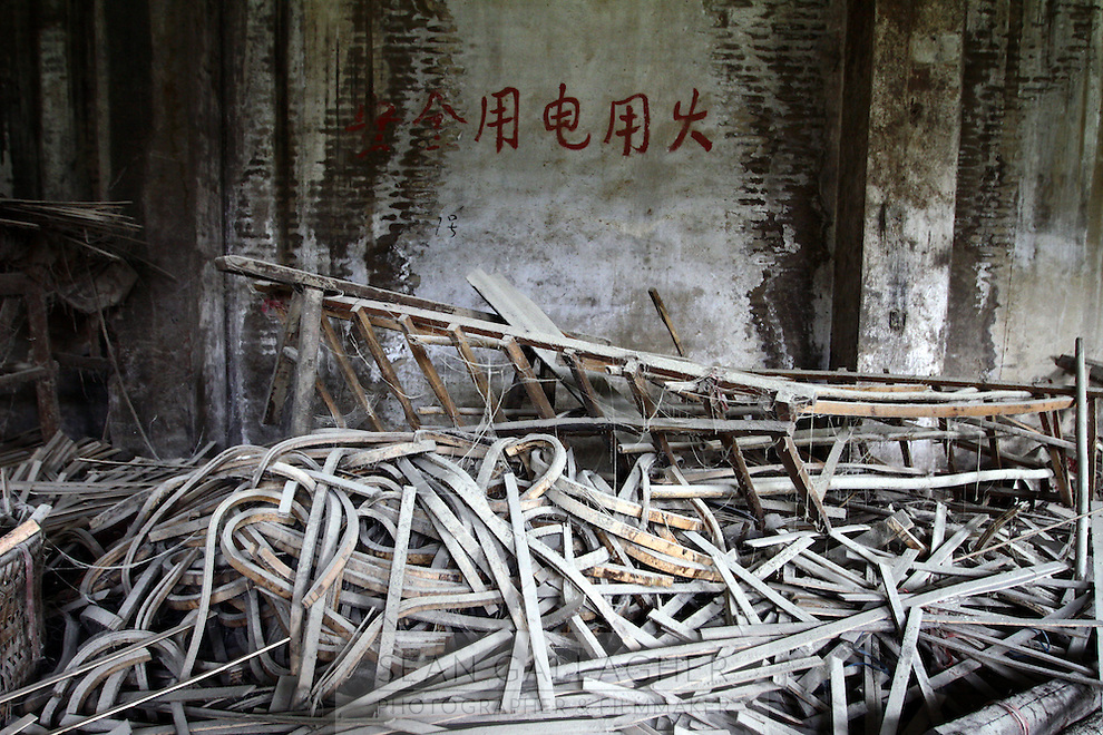 Off-cuts lie discarded in a factory which produces furniture and chopsticks, all of which is made from bamboo.