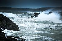 Justine Curgenven kayaking among huge waves, North Wales