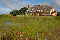 Corolla, North Carolina, Outer Banks.  Currituck Heritage Park, The Whalehead Club, built mid-1920s.  Cattails (bulrushes) growing in foreground.