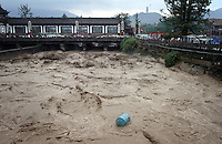 """Flood waters during the summer are channeled though the Dujiangyan Irrigation System. The system is regarded as an """"ancient Chinese engineering marvel."""" By naturally channeling water from the Min River during times of flood, the irrigation system served to protect the local area from flooding and provide water to the Chengdu basin. Sichuan Province. 2010"""