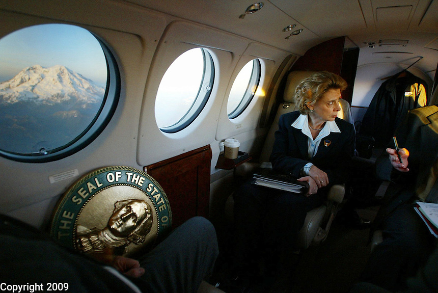 Governor Chris Gregoire is too busy to enjoy the view of Mt. Rainier outside her window on her way back from her trip to Yakima, Washington during her first 100 days in office.