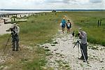 Shellness point, twitchers, bird watchers,  and holidaymakers near Leysdown. Isle of Sheppey Kent UK.