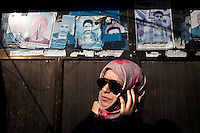 Sarah Jamal Ahmed, a 24 year old sociologist who was one of the activists leading the charge on Change Square in Sana'a stands by posters of dead protestors adorning the streets.