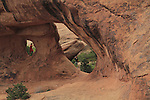 Visitors at Partition & Navajo Arches, Arches National Park, Utah. <br />