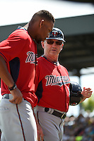Minnesota Twins third base coach Gene Glynn (13) talks with Byron Buxton (70) during a Spring Training game against the Pittsburgh Pirates on March 13, 2015 at McKechnie Field in Bradenton, Florida.  Minnesota defeated Pittsburgh 8-3.  (Mike Janes/Four Seam Images)