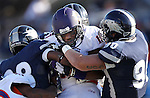 Northwestern State's Louis Hollier (17) struggles against Nevada defenders during the first half of an NCAA college football game Saturday, Sept. 15, 2012, in Reno, Nev. (AP Photo/Cathleen Allison)