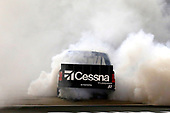 #51: Kyle Busch, Kyle Busch Motorsports, Toyota Tundra Cessna celebrates his win with a burnout