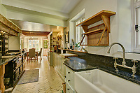 BNPS.co.uk (01202) 558833<br /> Pic: KnightFrank/BNPS<br /> <br /> The kitchen<br /> <br /> A historic English country estate with a French chateau feel and royal connections is on the market for £5.5m.<br /> <br /> The site of Grade II listed Yarner House was once governed by William the Conqueror, mentioned in the Domesday Book and a popular hunting site in Tudor times.<br /> <br /> The seven-bedroom house sits in a 247-acre estate on the edge of Dartmoor National Park and has stunning views over the surrounding landscape, including Yarner Wood.<br /> <br /> The ancient woodland was once part of the property until 1952 when it was sold to the Nature Conservancy to become one of the first national nature reserves.<br /> <br /> Where the current Yarner House is built, it is thought to have had a hunting lodge in Tudor times, with connections to Henry VII, Henry VIII, Edward VI and Queen Mary.