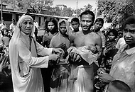 """Calcutta, India. April 04, 1975. Each day, Mother Teresa walked the streets of Calcutta. People paid her devotion as she passed, and in turn she showed interest in them and gave them her blessing. Mother Teresa (Agnes Gonxha Boyaxihu) the Roman Catholic, Albanian nun revered as India's """"Saint of the Slums,"""" was awarded the 1979 Nobel Peace Prize."""