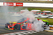 #19: Martin Truex Jr., Joe Gibbs Racing, Toyota Camry Bass Pro Shops celebrates his win with a burnout