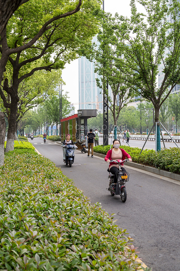 Suzhou, Jiangsu, China.  Many Cities Have Traffic Lanes Dedicated to Use by Motorbikes, Bicycles, and other small Vehicles.