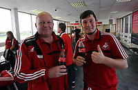 Wednesday 28 August 2013<br /> Pictured: Michel Eames (R) at Cardiff Airport.<br /> Re: Swansea City FC players and staff en route for their UEFA Europa League, play off round, 2nd leg, against Petrolul Ploiesti in Romania.