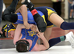 WOODBURY, CT, 12 FEBRUARY 2011-021211JW06-- Housatonic wrestler Dom Sanchez tries for the pin of Oliver Wolcott Tech Allan Greco for the win in the 125 weight class during the 2011 Berkshire League Championships at Nonnewaug High school.<br /> Jonathan Wilcox Republican-American