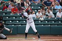 Yoelqui Cespedes (15) of the Winston-Salem Dash at bat against the Greensboro Grasshoppers at Truist Stadium on June 19, 2021 in Winston-Salem, North Carolina. (Brian Westerholt/Four Seam Images)