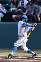 Trent Chatterton #8 of the UCLA Bruins bats against the Cal Poly Mustangs at Jackie Robinson Stadium on February 22, 2014 in Los Angeles, California. Cal Poly defeated UCLA, 8-0. (Larry Goren/Four Seam Images)