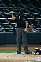 Home plate umpire Sean Cassidy makes a strike call during the game between the Asheville Tourists and the Winston-Salem Dash at Truist Stadium on September 17, 2021 in Winston-Salem, North Carolina. (Brian Westerholt/Four Seam Images)