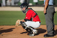 Kannapolis Intimidators catcher Brett Austin (20) looks to the dugout for the pitch call during the game against the Hickory Crawdads at CMC-Northeast Stadium on May 21, 2015 in Kannapolis, North Carolina.  The Intimidators defeated the Crawdads 2-0 in game one of a double-header.  (Brian Westerholt/Four Seam Images)