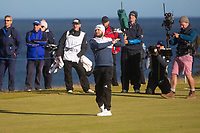 1st October 2021; Kingsbarns Golf Links, Fife, Scotland; European Tour, Alfred Dunhill Links Championship, Second round; Tyrrell Hatton of England lets go of his club as he hits his second shot on the par five ninth hole at Kingsbarns Golf Links