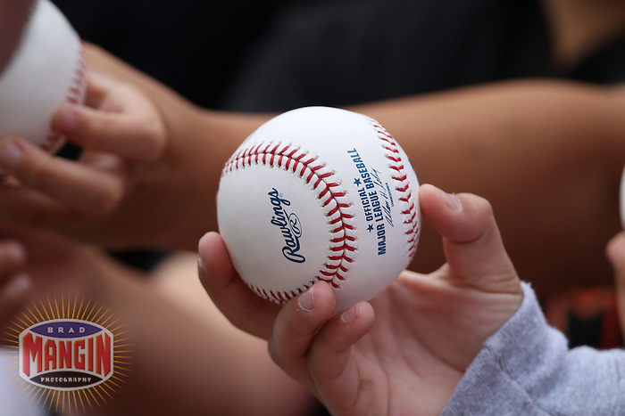 SAN FRANCISCO - SEPTEMBER 19:  A fan holds a baseball trying to get an autograph before the game between the Milwaukee Brewers and San Francisco Giants at AT&T Park on September 19, 2010 in San Francisco, California. Photo by Brad Mangin