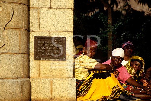 Ujiji, Tanzania. Local women sitting beside the monument where David Livingstone met Henry Moreton Stanley.
