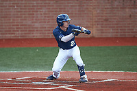 Clayton Nestor (23) of the Wingate Bulldogs squares to bunt against the Concord Mountain Lions at Ron Christopher Stadium on February 1, 2020 in Wingate, North Carolina. The Bulldogs defeated the Mountain Lions 8-0 in game one of a doubleheader. (Brian Westerholt/Four Seam Images)