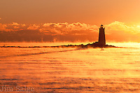 Sunrise over Whaleback Lighthouse from New Castle, NH on a frigid, below zero morning.