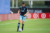 LAKE BUENA VISTA, FL - JULY 23: Jasser Khmiri #20 of Vancouver Whitecaps FC dribbles the ball during a game between Chicago Fire and Vancouver Whitecaps at Wide World of Sports on July 23, 2020 in Lake Buena Vista, Florida.