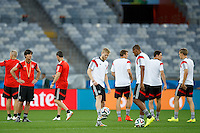 Germany manager Joachim Low watches his players Andre Schurrle and Jerome Boateng