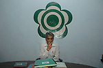 INDIA (West Bengal - Darjeeling) June 2007,Rajah Banerjee the owner of Makaibari Tea Estate sitting in front of Makaibari Tea Estate logo during a weekly meeting. Makaibari produces the most expensive tea in the world. They produce the tea organically (without using any fertilizers or spraying pesticides)through permaculture.  Makaibari is situated at the misty foot hills of Darjeeling Himalayas - Arindam Mukherjee