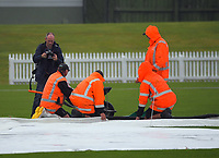 Photographer William Booth photographs ground staff before the cancellation of the Ford Trophy one-day cricket match between the Central Stags and Wellington Firebirds at Fitzherbert Park in Palmerston North, New Zealand on Tuesday, 8 December 2020. Photo: Dave Lintott / lintottphoto.co.nz