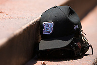 A Buffalo Bison cap sits on top of a glove in the dugout at Knights Castle June 22, 2009 in Fort Mill, South Carolina. (Photo by Brian Westerholt / Four Seam Images)