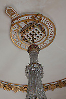 Close-up of a coat of arms ceiling rose, part of thre garter themed ceiling designed by Wyatville that one of the great drawing room chandeliers hangs from