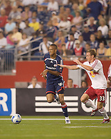 New England Revolution (18) Khano Smith changes direction as New York Red Bulls (33) Chris Leitch defends. New England Revolution defeated the New York Red Bulls, 2-1,  at Gillette Stadium on August 25, 2007.