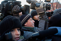 Reporters cover an illegal anti-Putin protest in Lubyanka Square, outside the former KGB headquarters.