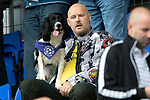St Johnstone v Kilmarnock…31.08.19   McDiarmid Park   SPFL<br />A saints fan in the crowd with his dog<br />Picture by Graeme Hart.<br />Copyright Perthshire Picture Agency<br />Tel: 01738 623350  Mobile: 07990 594431