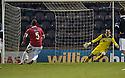 Deveronvale's Scott Fraser sends Raith goalkeeper Ross Laidlaw the wrong way to score form the spot ...