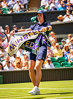 London, England, 2 th July, 2018, Tennis,  Wimbledon, Ballboy giving zowel to player<br /> Photo: Henk Koster/tennisimages.com