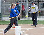 March 9, 2017- Tuscola, IL- Warrior Softball coaches Stephanie Maday and Lenny Sementi hit grounders to the infielders as they prepare for the 2017 season.  [Photo: Douglas Cottle]