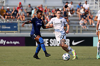 CARY, NC - SEPTEMBER 12: Taylor Smith #2 of the North Carolina Courage and Olivia Moultrie #42 of the Portland Thorns FC challenge for the ball during a game between Portland Thorns FC and North Carolina Courage at Sahlen's Stadium at WakeMed Soccer Park on September 12, 2021 in Cary, North Carolina.