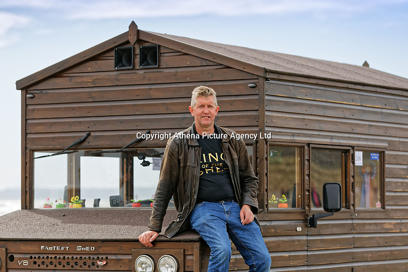 """Pictured: Kevin Nicks with his Fastest Shed in Pendine, west Wales, UK. Saturday 12 May 2018<br /> Re: A motorised shed has broken its own land speed record on a Welsh beach as it hit over 100mph.<br /> The Fastest Shed smashed its previous 80mph (129km/h) record for the fastest shed at a land speed event at Pendine Sands in Carmarthenshire.<br /> Its owner, gardener Kevin Nicks said it was """"marvellous"""" to hit 101.043mph (160 km/h) in what he said was the only road legal shed with an engine in the world.<br /> Mr Nicks, from Chipping Norton in Oxfordshire, created his bespoke shed on wheels, which now boasts a turbo-charged 450 brake horsepower turbo engine that is more powerful than many sports cars."""