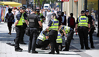 Pictured: Police officers lift man hole covers in Queen Street, the main shopping district of Cardiff Thursday 25 May 2017<br />