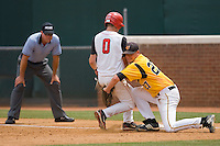 Matt Wessinger #0 of the St. John's Red Storm collides with Brent Mikionis #27 of the VCU Rams after a pick-off attempt at the Charlottesville Regional of the 2010 College World Series at Davenport Field on June 5, 2010, in Charlottesville, Virginia.  The Red Storm defeated the Rams 8-6.  Photo by Brian Westerholt / Four Seam Images