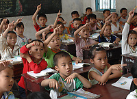 Children in class at the Danzhou Shi Yan Primary school, Danzhou City, Hainan Island, China,  25th April 2007. Danzhou city has the highest gender inbalance in China with 170 males born for every 100 females according to figures from Chinese Government 5t National Census. The inbalance is already having a massive social impact on society and is expected to get worse while the ruthless One Child Policy, aimed at curbingChina's 1.3 billion population, continues to be law.<br /><br />photo by Richard Jones/Sinopix