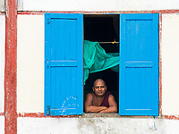 Buddhist Monk at the Monastery Window, Rakhine State, Myanmar